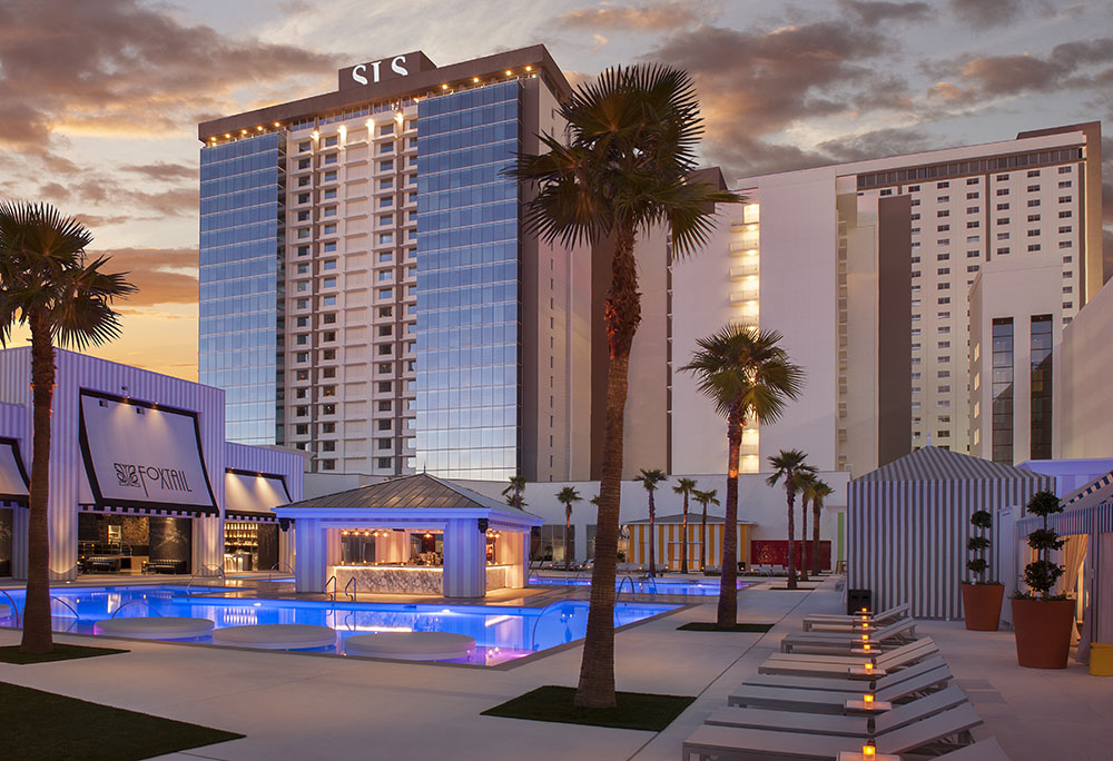 Exterior of SLS Las Vegas' Grand Tower with Foxtail Pool in an evening/sunset setting